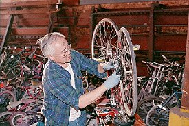 Roland repairing bicycles