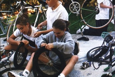 Children Fixing Bikes for Refugee Children